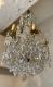 Lustre ancien à pampilles en cristal taillé, monture bronze 9 lumières XIXe - 4
